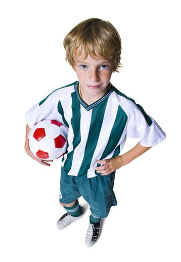High angle view of a boy holding a soccer ball : Stock Photo