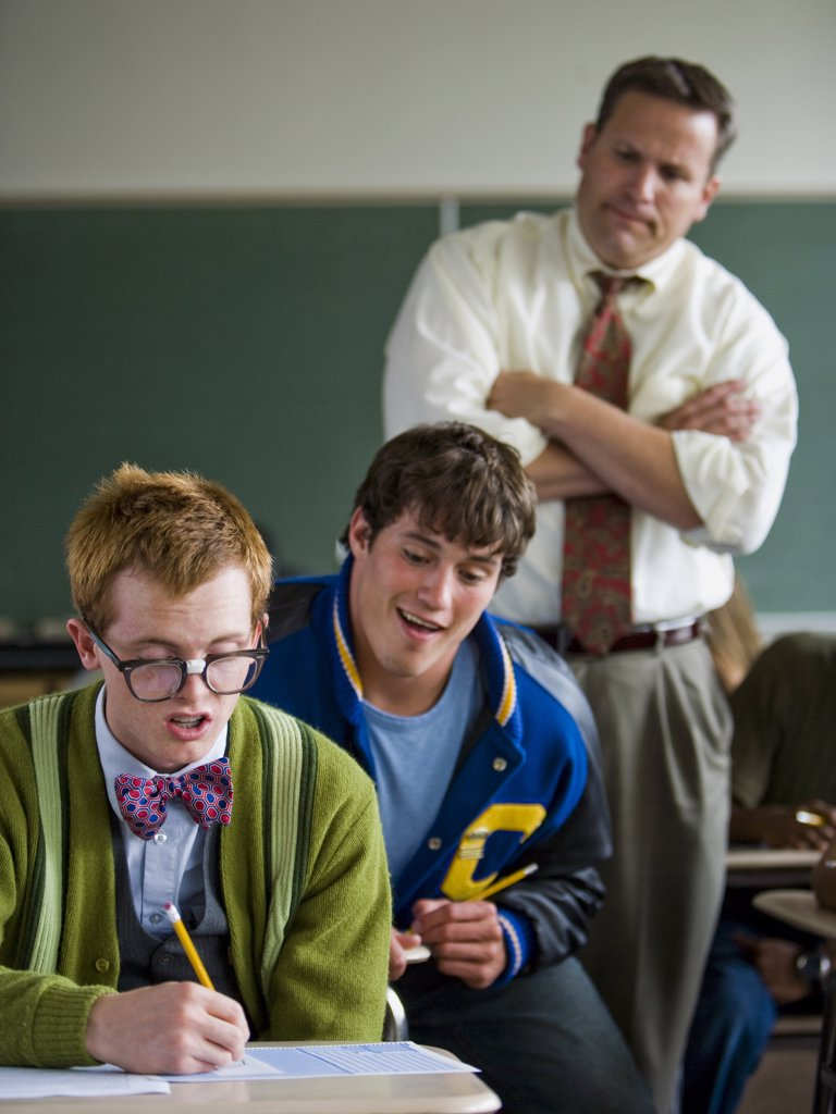 Stock Photo: 1660R-36650 High School cheating off of a Nerd.