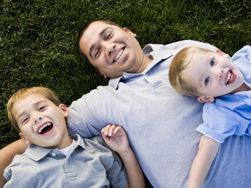 Family lying on the grass. : Stock Photo