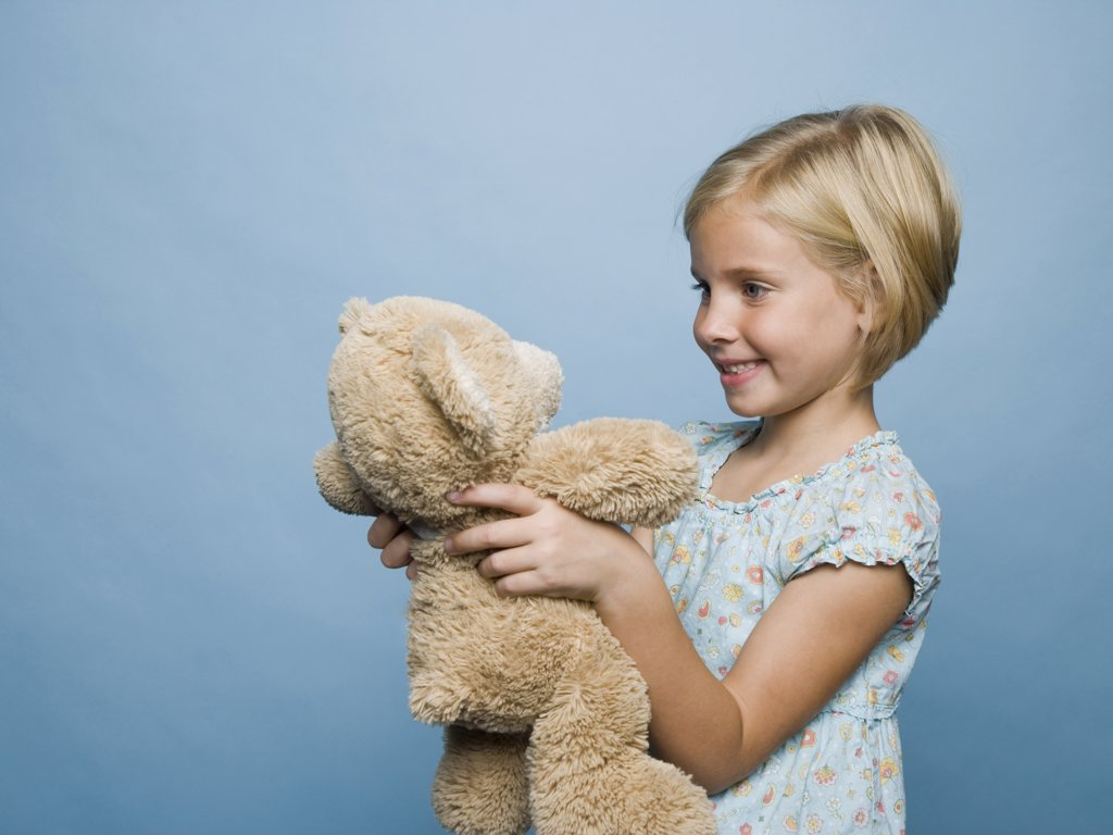 Stock Photo: 1660R-37327 girl hugging teddy bear.