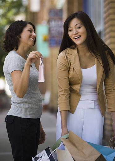 Stock Photo: 1660R-3738 Young woman with an adult woman carrying shopping bags