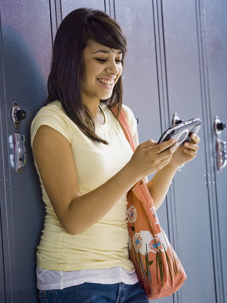 young woman with a handheld video game : Stock Photo