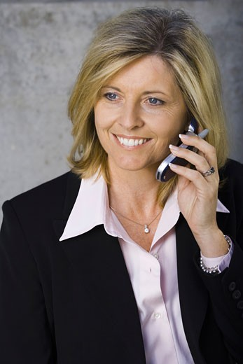Stock Photo: 1660R-3779 Close-up of a businesswoman talking on a mobile phone