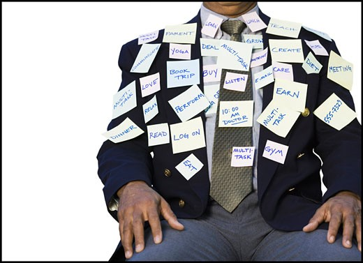 Stock Photo: 1660R-3808 Mid section view of a businessman sitting with stickers on his suit