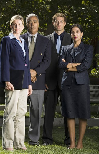 Stock Photo: 1660R-3809 Portrait of four business executives standing