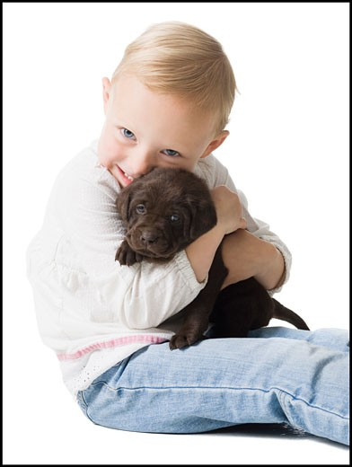 child with puppy : Stock Photo