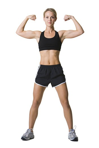 Stock Photo: 1660R-3827 Portrait of a young woman flexing her muscles