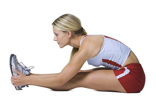 Profile of a young woman exercising : Stock Photo