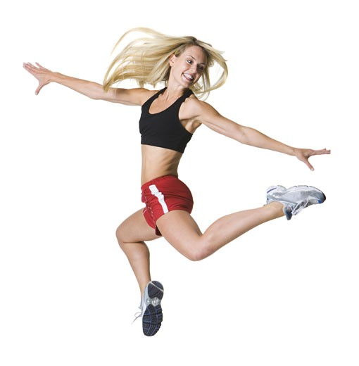 Stock Photo: 1660R-3854 Young woman jumping with her arms outstretched