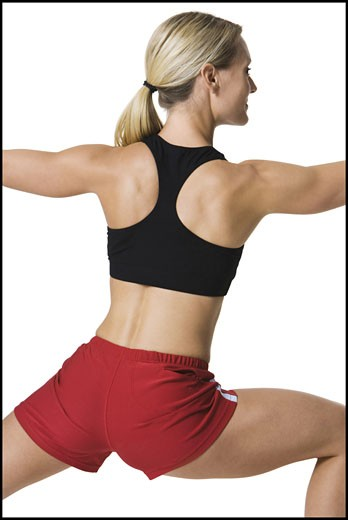 Stock Photo: 1660R-3857 Rear view of a young woman stretching
