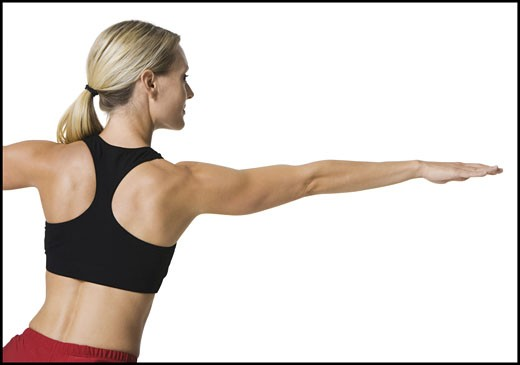 Stock Photo: 1660R-3858 Rear view of a young woman stretching