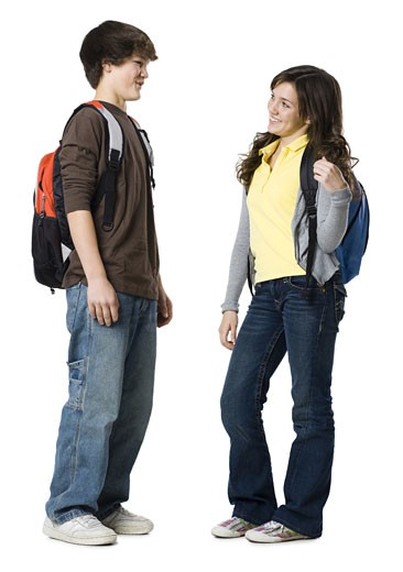 Students with book bags posing : Stock Photo