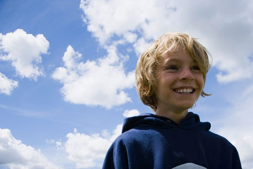 Low angle view of a boy smiling : Stock Photo