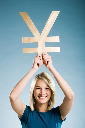 Stock Photo: 1660R-40317 woman holding up a yen symbol
