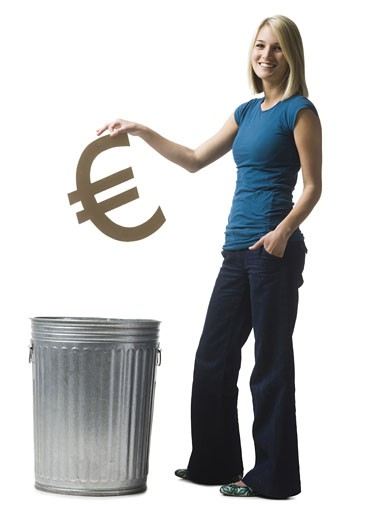 Stock Photo: 1660R-40459 woman throwing euro symbol in the trash