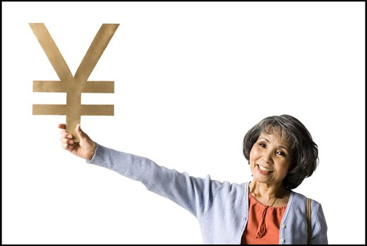 Stock Photo: 1660R-40526 woman holding currency symbol