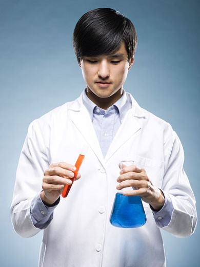 Stock Photo: 1660R-40729 scientist holding test tubes