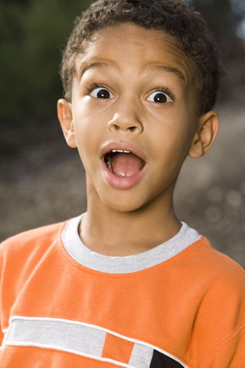 Stock Photo: 1660R-4088 Portrait of a boy with his mouth open