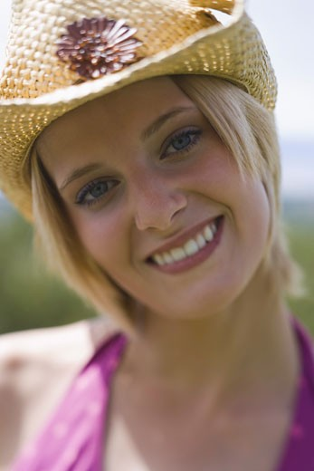 Stock Photo: 1660R-4148 Portrait of a young woman smiling