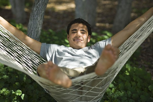 Stock Photo: 1660R-4170 Portrait of a young man relaxing in a hammock