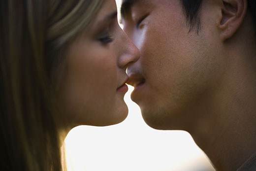 Stock Photo: 1660R-4230 Close-up of a young man and woman kissing