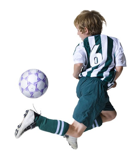 Stock Photo: 1660R-4251 Rear view of a boy playing a soccer ball