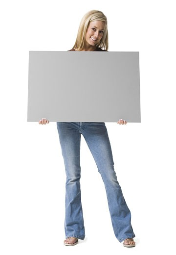 Stock Photo: 1660R-4270 Portrait of a young woman holding a blank sign