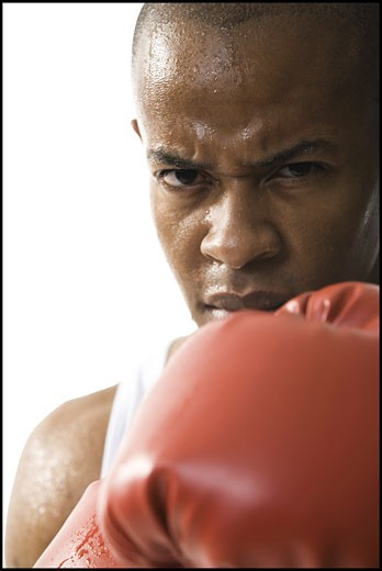 Stock Photo: 1660R-4303 Portrait of a young man wearing boxing gloves