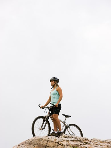 mountain biker on a rocky ridge : Stock Photo