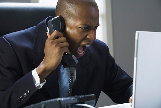 Stock Photo: 1660R-4357 Close-up of a businessman shouting on the phone