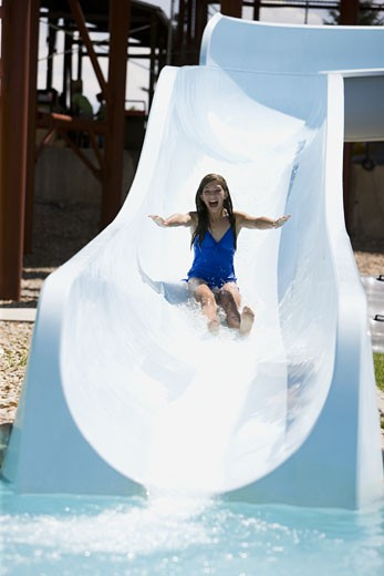 Stock Photo: 1660R-43840 woman on a water slide
