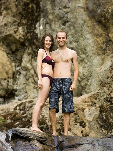 Stock Photo: 1660R-43936 couple standing above a rock waterslide