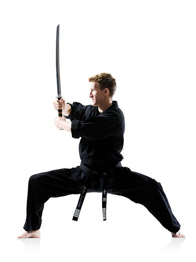 man in a black karate gi practicing martial arts : Stock Photo