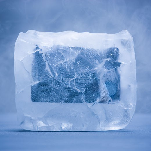 credit card frozen in a solid block of ice : Stock Photo