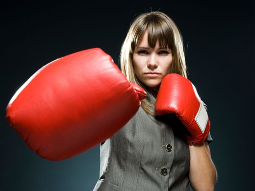 Stock Photo: 1660R-44336 businesswoman wearing boxing gloves