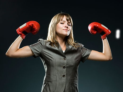 Stock Photo: 1660R-44337 businesswoman wearing boxing gloves
