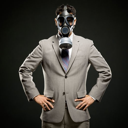 businessman wearing a gas mask : Stock Photo