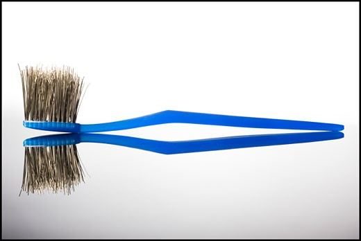 Stock Photo: 1660R-44458 toothbrush with the bristles made of metal wires