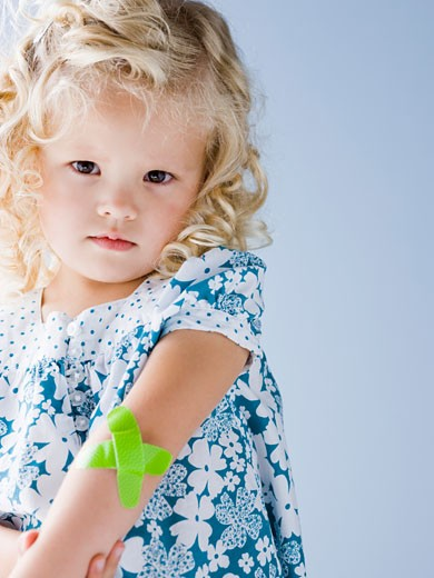 Stock Photo: 1660R-44512 little girl with a bandaid on her arm
