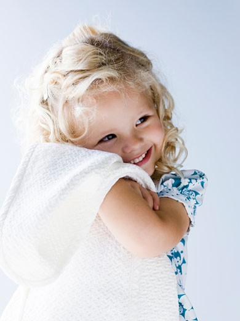 Stock Photo: 1660R-44529 little girl holding her blanket