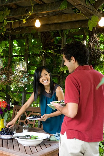 two people enjoying an outdoor meal : Stock Photo