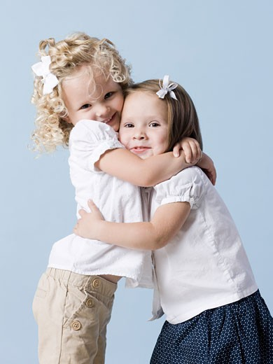 Stock Photo: 1660R-44786 two little girls hugging