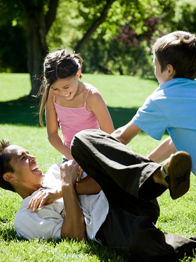 dad in the park with his two kids : Stock Photo