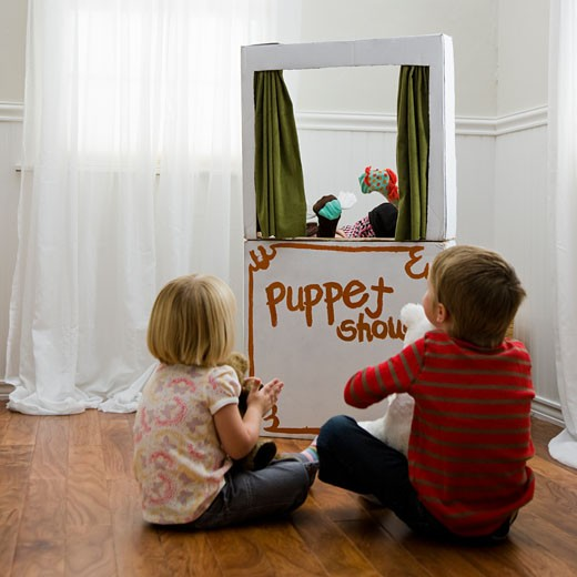 Stock Photo: 1660R-45150 children watching a puppet show
