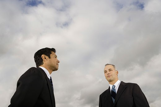 Stock Photo: 1660R-4593 Low angle view of two businessmen standing