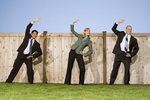 Stock Photo: 1660R-4610 Low angle view of two businessmen and a businesswoman exercising