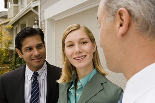 Stock Photo: 1660R-4626 Close-up of a businesswoman and two businessmen smiling