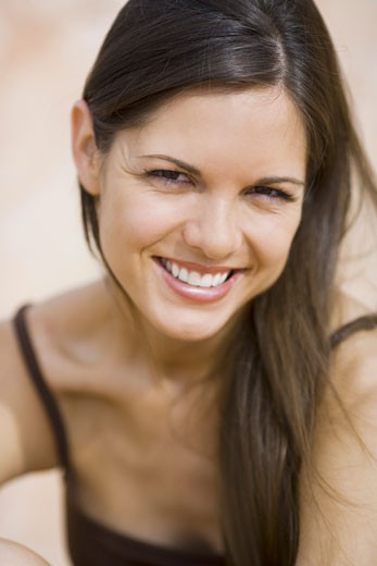 Stock Photo: 1660R-4767 Portrait of a young woman smiling