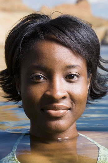 Stock Photo: 1660R-4905 Portrait of a young woman in a lake