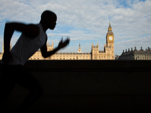 Stock Photo: 1660R-49563 UK, London, Man running in front of Westminster skyline